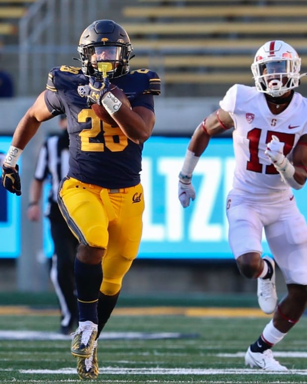 Damien Moore finds running room against Stanford in the Big Game.