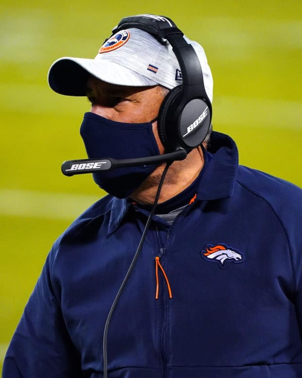 Denver Broncos manager Vic Fangio looks on during the first half against the Denver Broncos at Arrowhead Stadium.