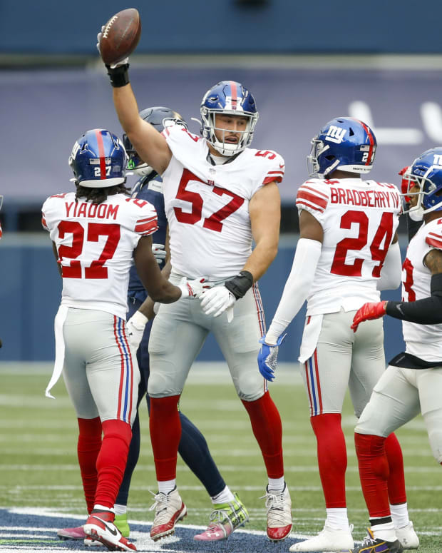 Dec 6, 2020; Seattle, Washington, USA; New York Giants defensive end Niko Lalos (57) reacts after recovering a fumble against the Seattle Seahawks during the second quarter at Lumen Field.