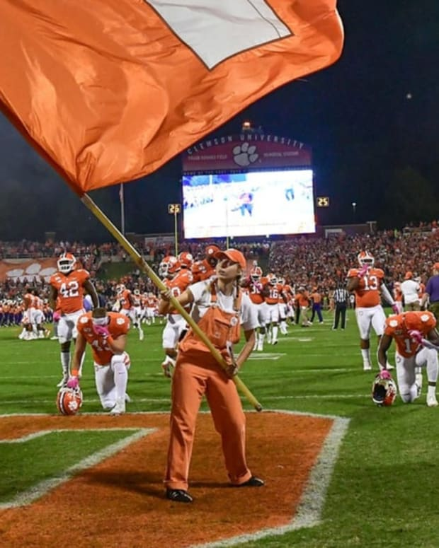 Clemson players kneel in end zone of Memorial Stadium prior to a game