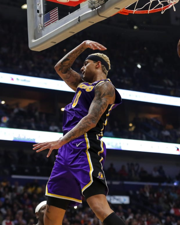 Mar 1, 2020; New Orleans, Louisiana, USA; Los Angeles Lakers forward Kyle Kuzma (0) dunks the ball against the New Orleans Pelicans during the first quarter at the Smoothie King Center.