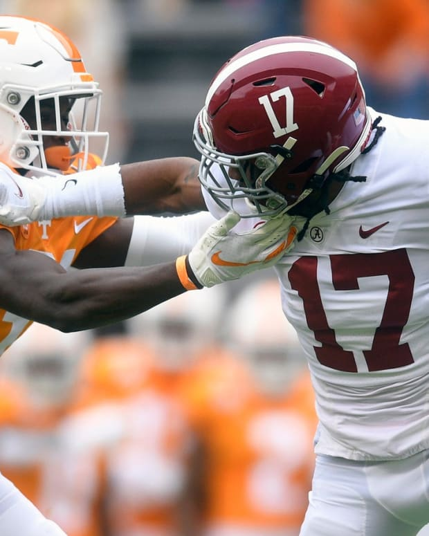 Alabama Jaylen Waddle returns the opening kickoff vs. Tennessee and left the game after sustaining a broken ankle on the play.