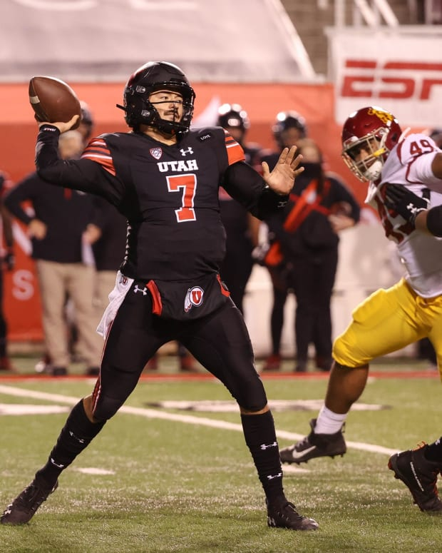 Nov 21, 2020; Salt Lake City, Utah, USA; Utah Utes quarterback Cameron Rising (7) throws the ball down the field against the USC Trojans during the first quarter at Rice-Eccles Stadium.