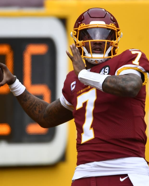 Dec 20, 2020; Landover, Maryland, USA; Washington Football Team quarterback Dwayne Haskins Jr. (7) warms up on the field before a game against the Seattle Seahawks at FedExField. Mandatory Credit: Brad Mills-USA TODAY Sports