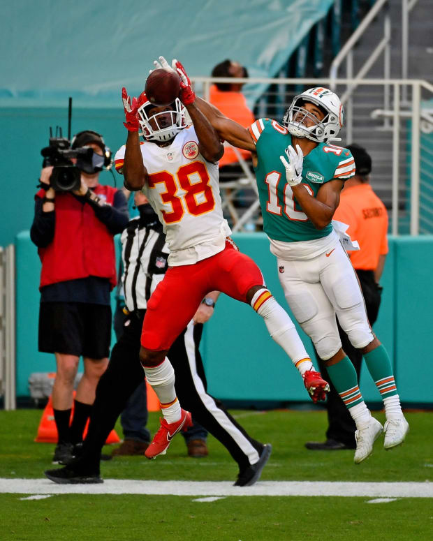 Dec 13, 2020; Miami Gardens, Florida, USA; Kansas City Chiefs cornerback L'Jarius Sneed (38) breaks up a pass to Miami Dolphins running back Malcolm Perry (10) during the second half at Hard Rock Stadium. Mandatory Credit: Jasen Vinlove-USA TODAY Sports