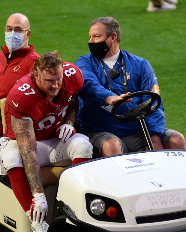 Arizona Cardinals tight end Maxx Williams (87) is carted off the field against the Philadelphia Eagles during the first half at State Farm Stadium.