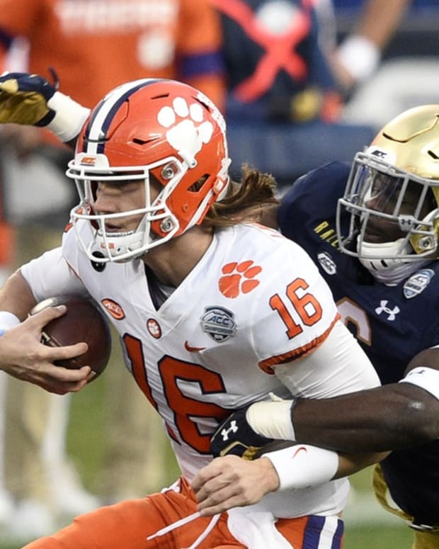 Clemson Tigers quarterback Trevor Lawrence (16) with the ball as Notre Dame Fighting Irish linebacker Jeremiah Owusu-Koramoah (6) defends in the second quarter at Bank of America Stadium.