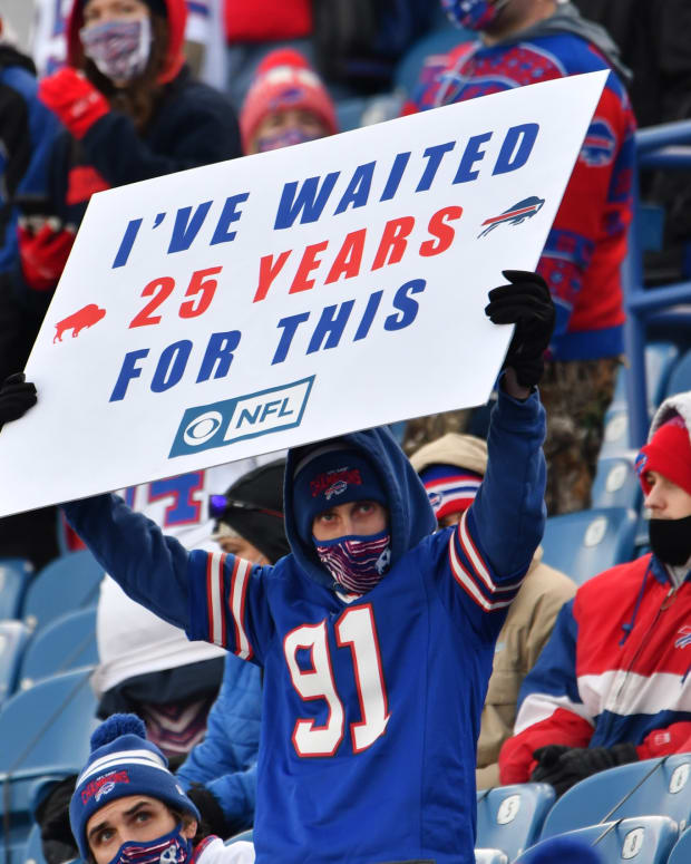 A Buffalo Bills fan displays a sign in the second quarter of a playoff game against the Indianapolis Colts at Bills Stadium.