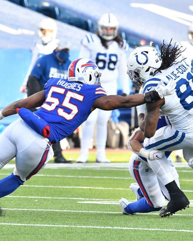 Indianapolis Colts tight end Mo Alie-Cox (81) is tackled by Buffalo Bills defensive end Jerry Hughes (55) in the third quarter at Bills Stadium.