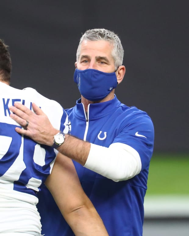 Indianapolis Colts head coach Frank Reich pats center Ryan Kelly on the back in Las Vegas.