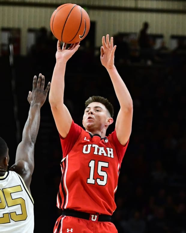 Jan 12, 2020; Boulder, Colorado, USA; Utah Utes guard Rylan Jones (15) shoots a three point basket attempt over Colorado Buffaloes guard McKinley Wright IV (25) in the second half at the CU Events Center.