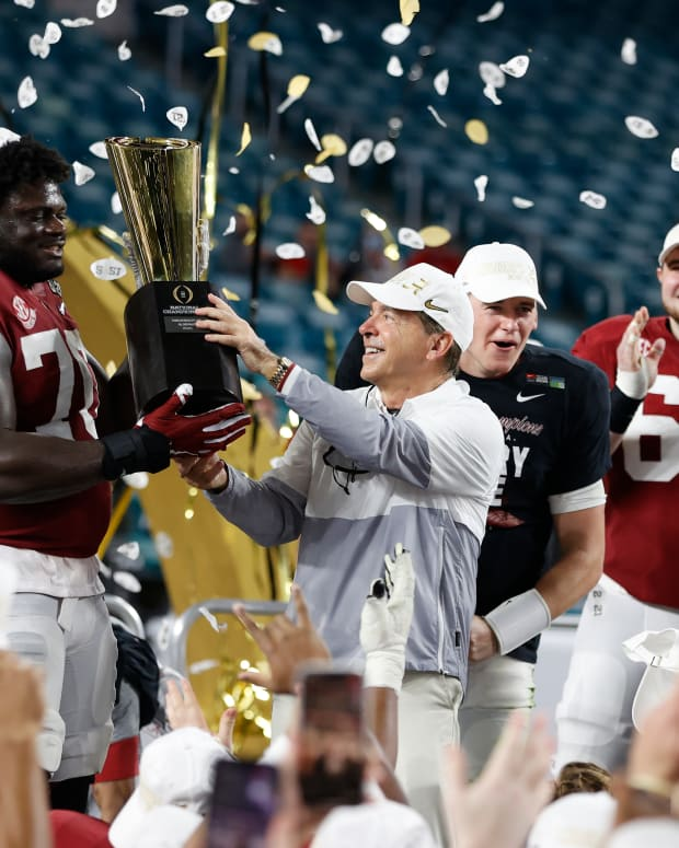 January 11, 2021, Alabama head coach Nick Saban and offensive lineman Alex Leatherwood after CFP National Championship in Miami, FL.