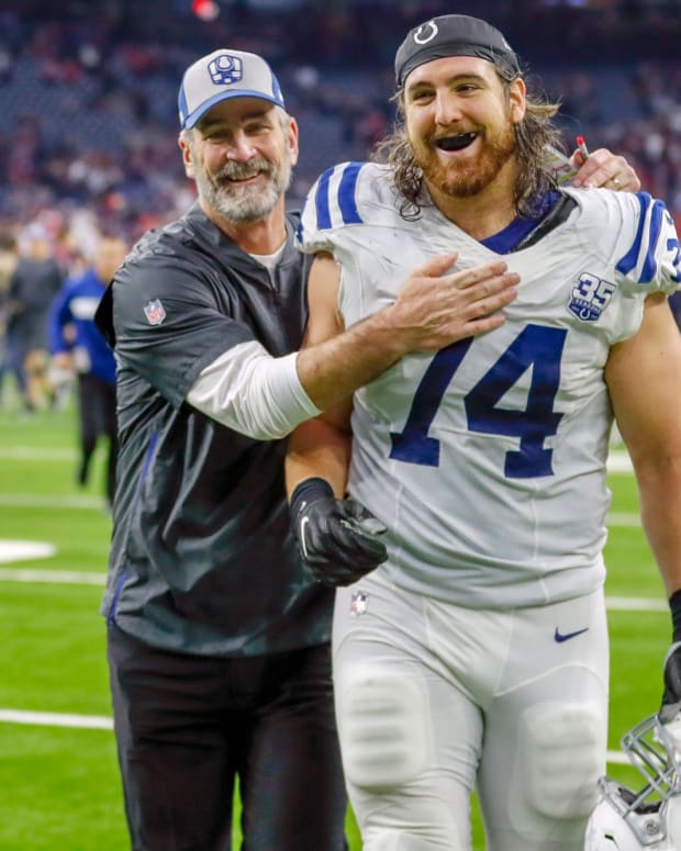 Indianapolis Colts head coach Frank Reich (left) congratulates offensive left tackle Anthony Castonzo after a 2018 win at Houston.