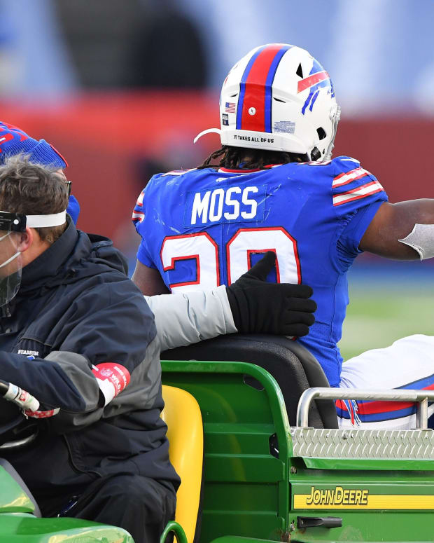 Jan 9, 2021; Orchard Park, New York, USA; Buffalo Bills running back Zack Moss (20) is taken to the locker room after suffering an apparent injury against the Indianapolis Colts during the second half in the AFC Wild Card game at Bills Stadium.