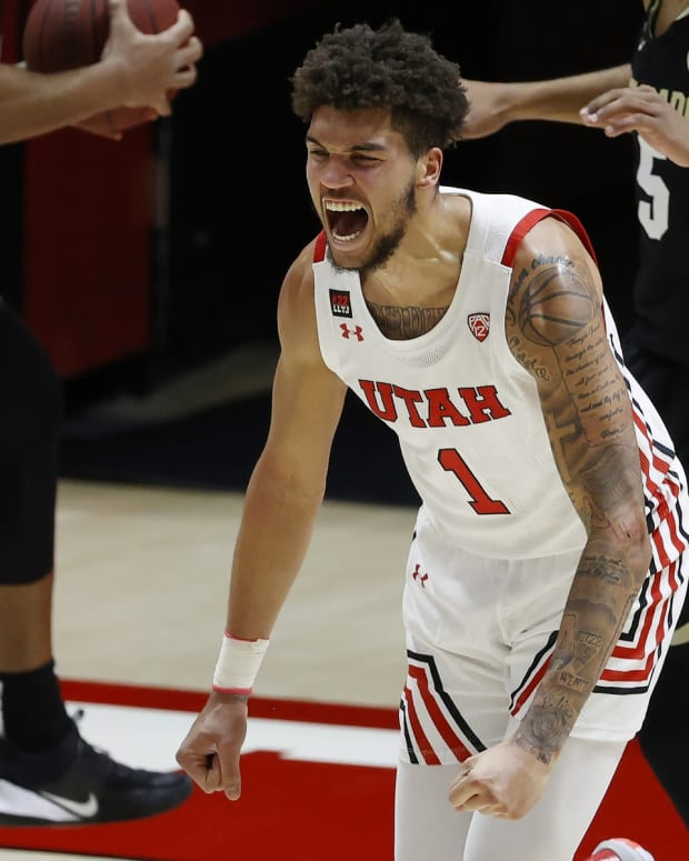 Jan 11, 2021; Salt Lake City, Utah, USA; Utah Utes forward Timmy Allen (1) reacts after a basket in the first half against the Colorado Buffaloes at Jon M. Huntsman Center.