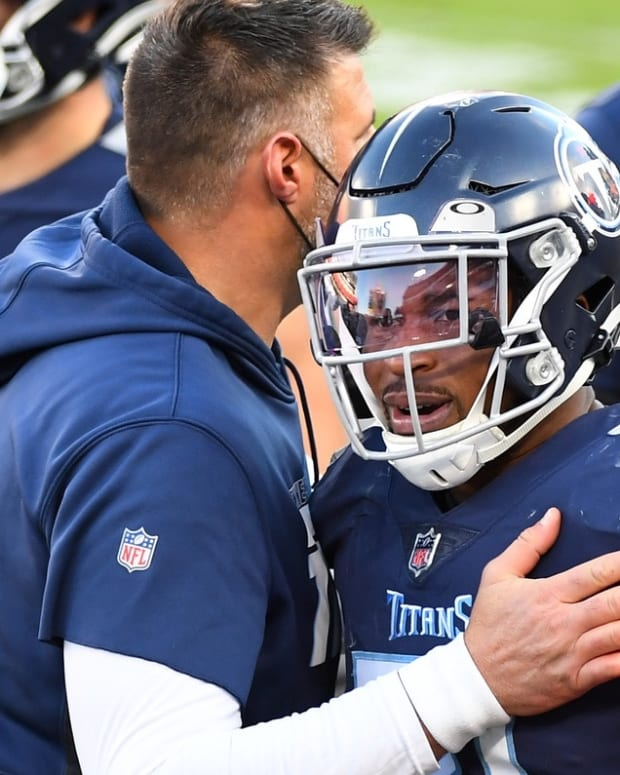 Tennessee Titans free safety Kevin Byard (31) is congratulated by Tennessee Titans head coach Mike Vrabel after intercepting a pass during the second half against the Detroit Lions at Nissan Stadium.