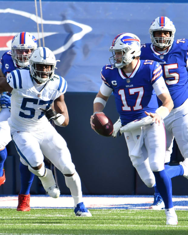 Bills quarterback Josh Allen (17) runs from Indianapolis Colts defensive end Kemoko Turay (57) in divisional round playoff game.