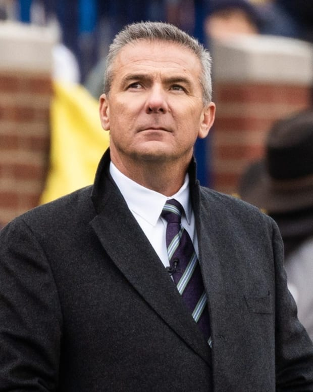 Former Ohio State coach Urban Meyer rewatches a play during the game at Michigan Stadium, Saturday, Nov. 30, 2019. Ohio State defeated Michigan, 56-27