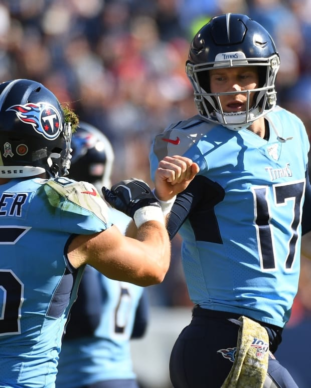 Tennessee Titans quarterback Ryan Tannehill (17) and Tennessee Titans tight end Anthony Firkser (86) celebrate after a touchdown during the first half against the Kansas City Chiefs at Nissan Stadium.