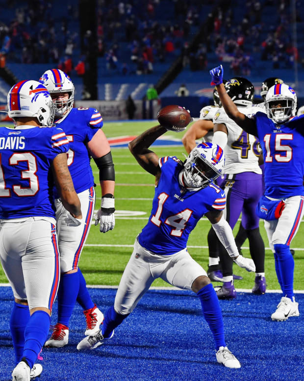 Bills wide receiver Stefon Diggs (14) celebrates after scoring a touchdown against the Baltimore Ravens during the second half of their AFC divisional round playoff game at Bills Stadium.