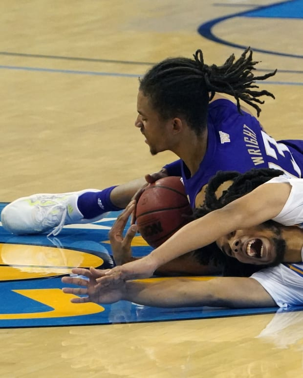 Hameir Wright, who had a career-best 15 points, dives for a loose ball.