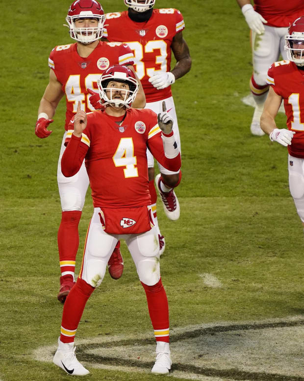Jan 17, 2021; Kansas City, Missouri, USA; Kansas City Chiefs quarterback Chad Henne (4) celebrates the victory against the Cleveland Browns in the AFC Divisional Round playoff game at Arrowhead Stadium. Mandatory Credit: Jay Biggerstaff-USA TODAY Sports