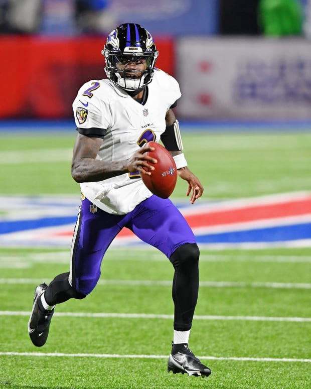 Jan 16, 2021; Orchard Park, New York, USA; Baltimore Ravens quarterback Tyler Huntley (2) runs with the ball against the Buffalo Bills during the second half of an AFC Divisional Round playoff game at Bills Stadium. The Buffalo Bills won 17-3.