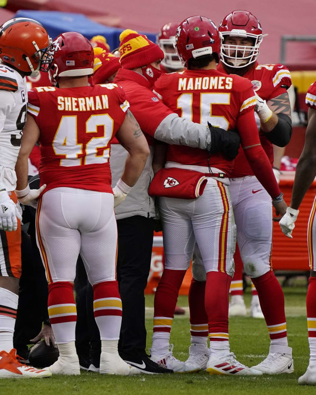 Jan 17, 2021; Kansas City, Missouri, USA; Kansas City Chiefs quarterback Patrick Mahomes (15) is slow getting up after being brought down by Cleveland Browns outside linebacker Mack Wilson (51) during the second half in the AFC Divisional Round playoff game at Arrowhead Stadium. Mahomes would be taken out for the remainder of the game. Mandatory Credit: Jay Biggerstaff-USA TODAY Sports
