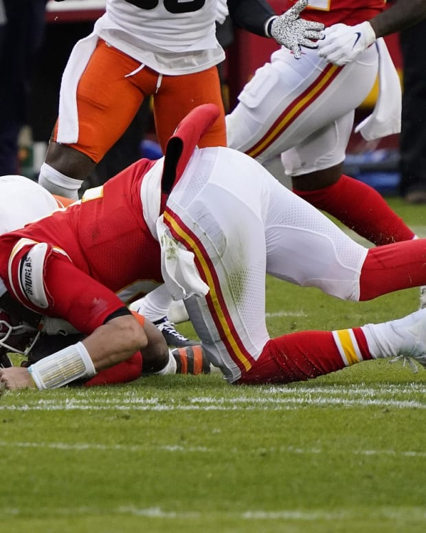 Jan 17, 2021; Kansas City, Missouri, USA; Kansas City Chiefs quarterback Patrick Mahomes (15) is brought down by Cleveland Browns outside linebacker Mack Wilson (51) during the second half in the AFC Divisional Round playoff game at Arrowhead Stadium. Mahomes would suffer an injury on the play. Mandatory Credit: Jay Biggerstaff-USA TODAY Sports