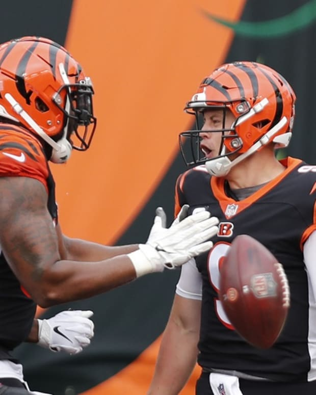 Sep 13, 2020; Cincinnati, Ohio, USA; Cincinnati Bengals quarterback Joe Burrow (9) reacts with offensive tackle Bobby Hart (left) after scoring a touchdown against the Los Angeles Chargers during the first half at Paul Brown Stadium. Mandatory Credit: David Kohl-USA TODAY Sports