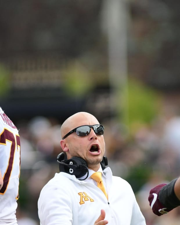 Minnesota Gophers head coach P.J. Fleck celebrates a touchdown with lineman Daniel Faalele (78) in the first half against the Purdue Boilermakers at Ross-Ade Stadium.