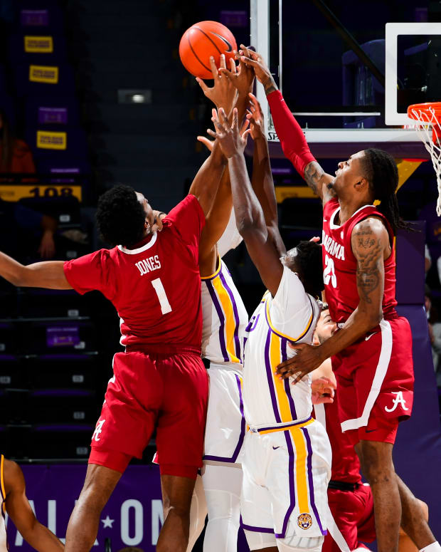 January 19, 2021, Alabama basketball players Herb Jones and John Petty Jr. battle for the rebound against LSU in Baton Rouge, LA.