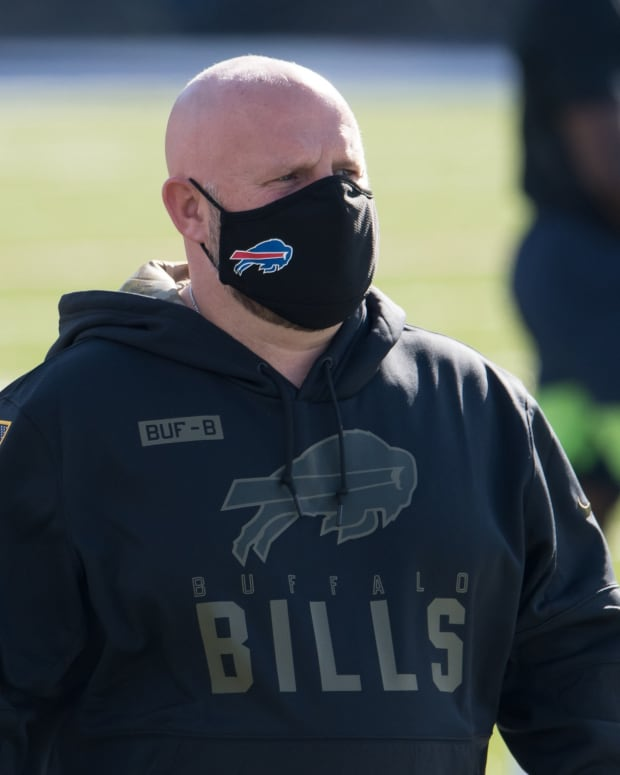 Bills offensive coordinator Brian Daboll walks the field prior to a game against the Seattle Seahawks at Bills Stadium.