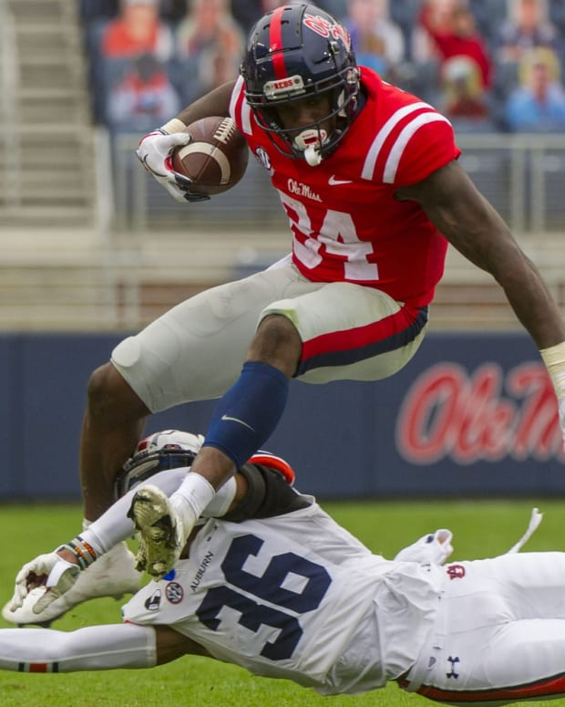 Oct 24, 2020; Oxford, Mississippi, USA; Mississippi Rebels tight end Kenny Yeboah (84) jumps over Auburn Tigers defensive back Jaylin Simpson (36) during the second half at Vaught-Hemingway Stadium.
