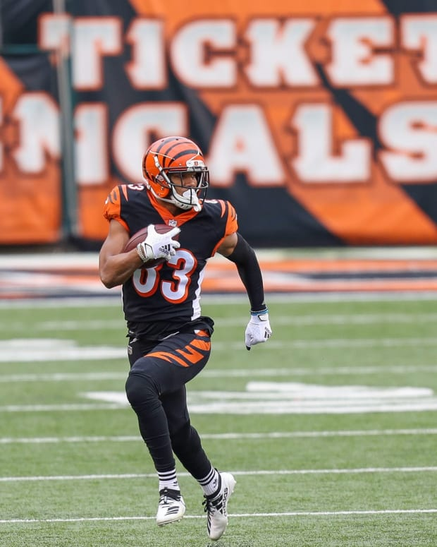 Dec 13, 2020; Cincinnati, Ohio, USA; Cincinnati Bengals wide receiver Tyler Boyd (83) runs with the ball against the Dallas Cowboys in the first half at Paul Brown Stadium. Mandatory Credit: Katie Stratman-USA TODAY Sports
