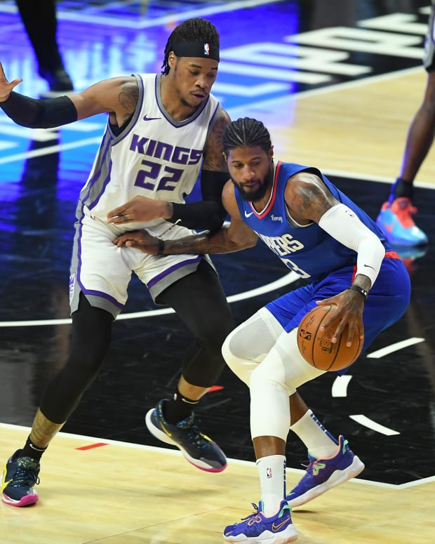 Jan 20, 2021; Los Angeles, California, USA; Sacramento Kings center Richaun Holmes (22) guards Los Angeles Clippers guard Paul George (13) in the first half of the game at Staples Center. Mandatory Credit: Jayne Kamin-Oncea-USA TODAY Sports