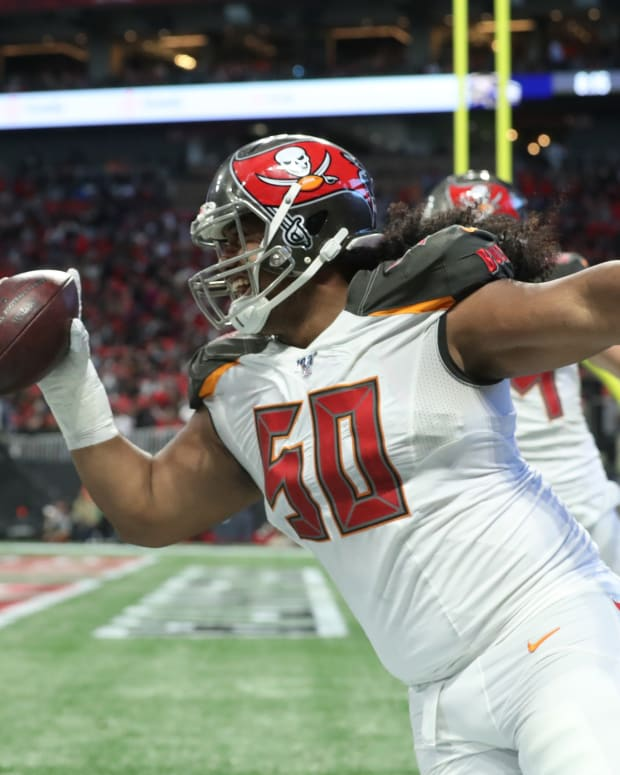 Vita Vea celebrates a TD pass he caught in 2019.