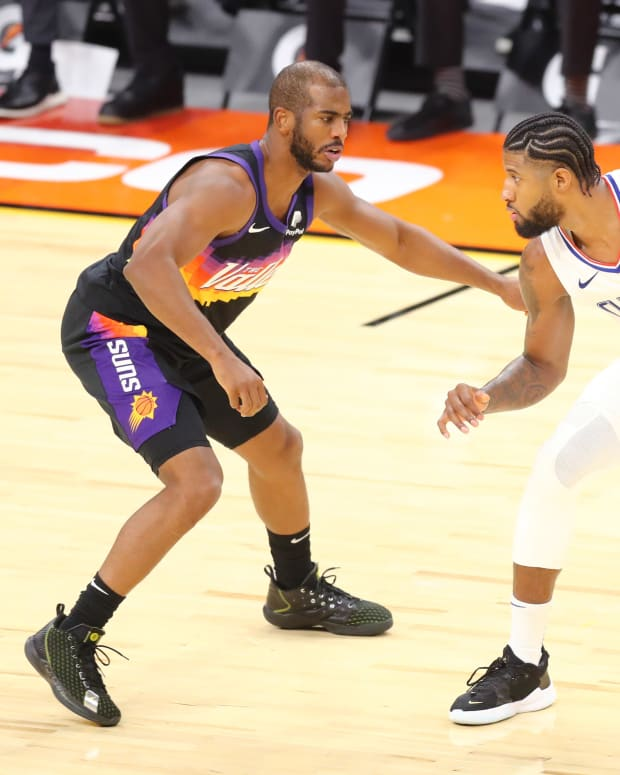 Jan 3, 2021; Phoenix, Arizona, USA; Los Angeles Clippers guard Paul George (13) dribbles against Phoenix Suns guard Chris Paul (3) in the second half at Phoenix Suns Arena. Mandatory Credit: Billy Hardiman-USA TODAY Sports