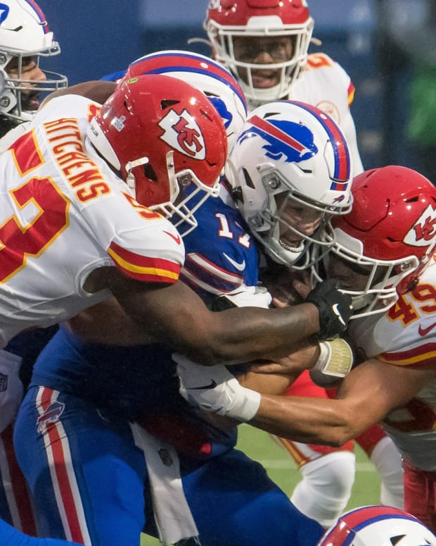 Oct 19, 2020; Orchard Park, New York, USA; Buffalo Bills quarterback Josh Allen (17) is tackled between Kansas City Chiefs inside linebacker Anthony Hitchens (53) and free safety Daniel Sorensen (49) in the first quarter at Bills Stadium. Mandatory Credit: Mark Konezny-USA TODAY Sports
