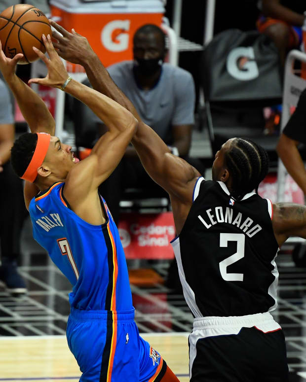 Jan 22, 2021; Los Angeles, California, USA; LA Clippers forward Kawhi Leonard (2) blocks a shot by Oklahoma City Thunder forward Darius Bazley (7) during the first quarter at Staples Center. Mandatory Credit: Robert Hanashiro-USA TODAY Sports
