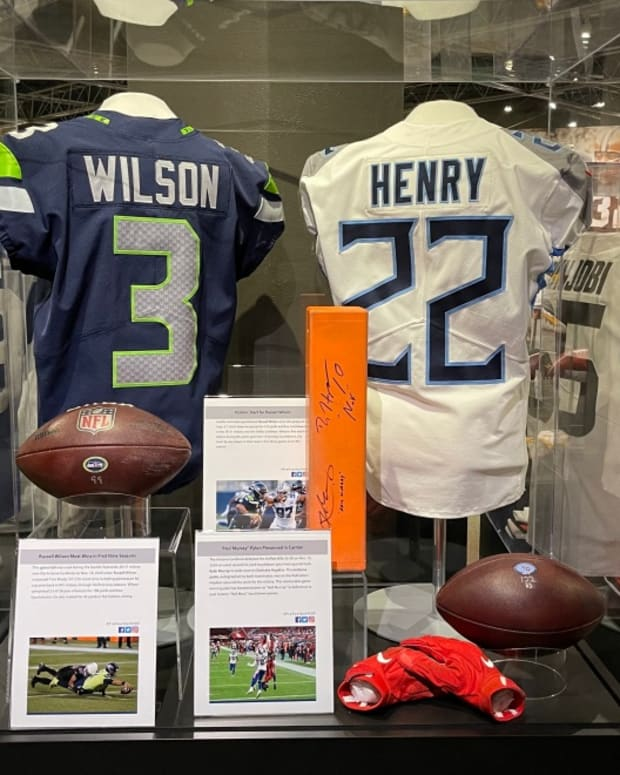 Memorabilia from Tennessee Titans running back Derrick Henry's 2,000-yard season on display at the Pro Football Hall of Fame.