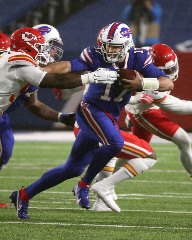 Josh Allen runs from Kansas City defenders during the Chiefs' 26-17 win against the Buffalo Bills at Bills Stadium on Oct. 19, 2020. Jg 101920 Bills 5 © Jamie Germano/Rochester Democrat and Chronicle via Imagn Content Services, LLC