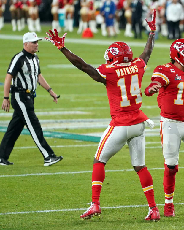 Feb 2, 2020; Miami Gardens, Florida, USA; Kansas City Chiefs quarterback Patrick Mahomes (15) and wide receiver Sammy Watkins (14) celebrate during the first quarter against the San Francisco 49ers in Super Bowl LIV at Hard Rock Stadium. Mandatory Credit: Kyle Terada-USA TODAY Sports