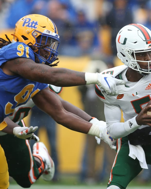 Pittsburgh Panthers defensive lineman Patrick Jones II (91) sacks Miami Hurricanes quarterback N'Kosi Perry (5) during the third quarter at Heinz Field. Miami won 16-12.