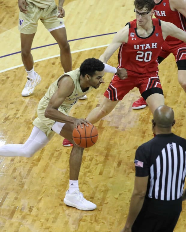 Jamal Bey drives to the basket against Utah.