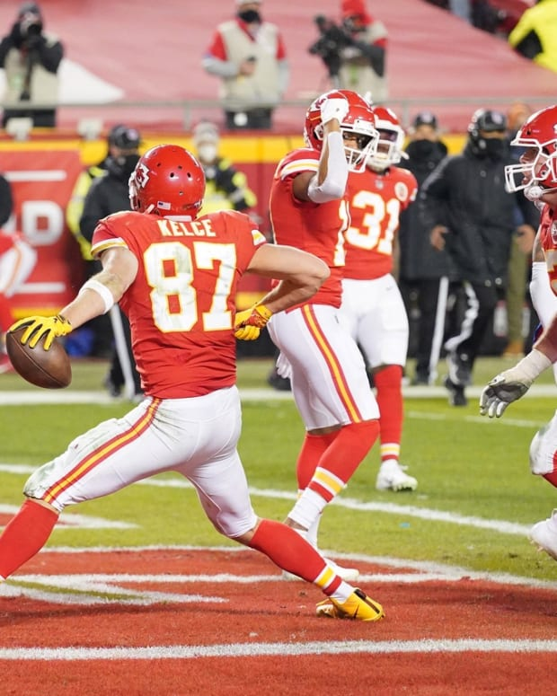 Chiefs tight end Travis Kelce (87) celebrates after scoring a touchdown against the Buffalo Bills during the third quarter in the AFC Championship Game at Arrowhead Stadium.