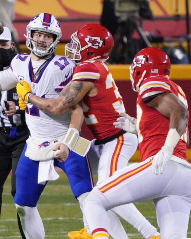 Jan 24, 2021; Kansas City, MO, USA; Buffalo Bills quarterback Josh Allen (17) is pressured by Kansas City Chiefs strong safety Tyrann Mathieu (32) during the second quarter in the AFC Championship Game at Arrowhead Stadium. Mandatory Credit: Denny Medley-USA TODAY Sports