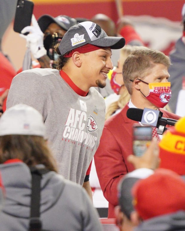 Jan 24, 2021; Kansas City, MO, USA; Kansas City Chiefs quarterback Patrick Mahomes (15) and team owner Clark Hunt are interviewed after defeating the Buffalo Bills in the AFC Championship Game at Arrowhead Stadium. Mandatory Credit: Denny Medley-USA TODAY Sports