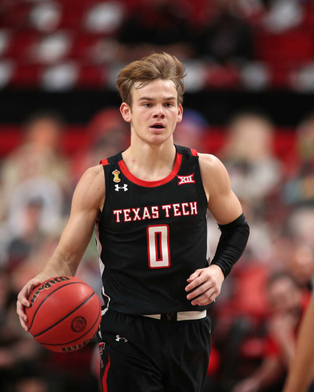 Jan 16, 2021; Lubbock, Texas, USA; Texas Tech Red Raiders guard Mac McClung (0) brings the ball up court against Baylor Bears guard MaCio Teague (31) in the first half at United Supermarkets Arena.