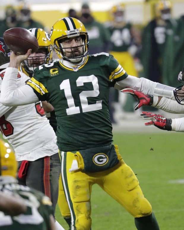 Jan 24, 2021, Green Bay, WI, USA; Green Bay Packers quarterback Aaron Rodgers (12) throws an inccomplete pass against Tampa Bay Buccaneers defensive end Ndamukong Suh (93) in the final minutes of the game during the NFC championship game Sunday, January 24, 2021, at Lambeau Field Mandatory credit: Dan Powers / Milwaukee Journal Sentinel via USA TODAY NETWORK
